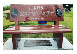 PIcture of granite cremation bench also called cremation niche bench or cremation memorial bench designed by the Iowa Memorial Granite Company for an Iowa family. It was set in an Iowa cemetery.