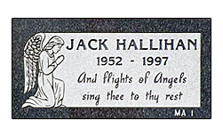 Flat grave marker designed by the Iowa Memorial Granite Company for Hallihan Family. The flat granite marker is set in located in an Iowa cemetery.