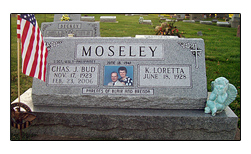 Picture of Iowa cemetery headstone designed and manufactured by the Iowa Memorial Granite Company for the Moseley family. The slant face raised headstone is located in St. Mary's Cemetery in Muscatine, Iowa.